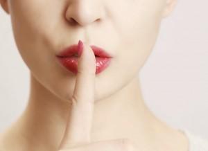 Finger-on-lips-silent-gesture-533776443_4582x3055-copy